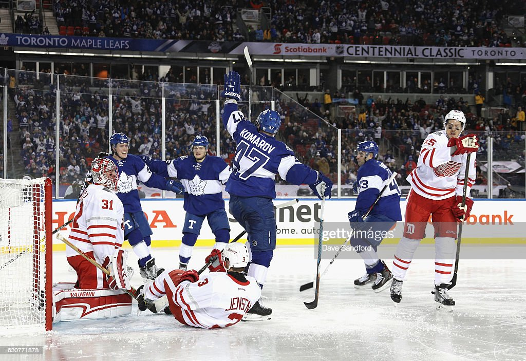 Leo Komarov #47 of the Toronto Maple Leafs celebrates with teammates after scoring a goal on goaltender Jared Coreau #31 of the Detroit Red Wings to tie the game in the third period of the 2017 Scotiabank NHL Centennial Classic at Exhibition Stadium on January 1, 2017 in Toronto, Ontario, Canada.