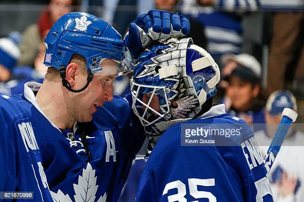 Leo Komarov of the Toronto Maple Leafs congratulates Jhonas Enroth after defeating the Vancouver Canucks 63 at the Air Canada Centre on November 5...