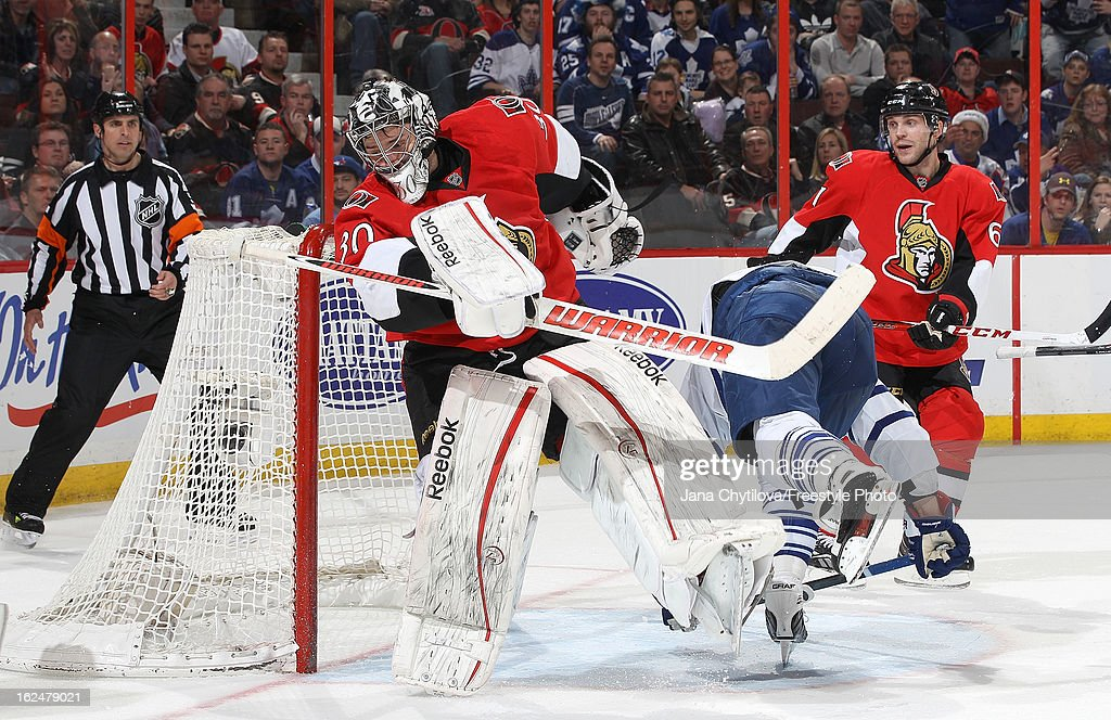 Leo Komarov #47 of the Toronto Maple Leafs crash into <a gi-track='captionPersonalityLinkClicked' href=/galleries/search?phrase=Ben+Bishop&family=editorial&specificpeople=700137 ng-click='$event.stopPropagation()'>Ben Bishop</a> #30 of the Ottawa Senators, during an NHL game at Scotiabank Place on February 23, 2013 in Ottawa, Ontario, Canada.
