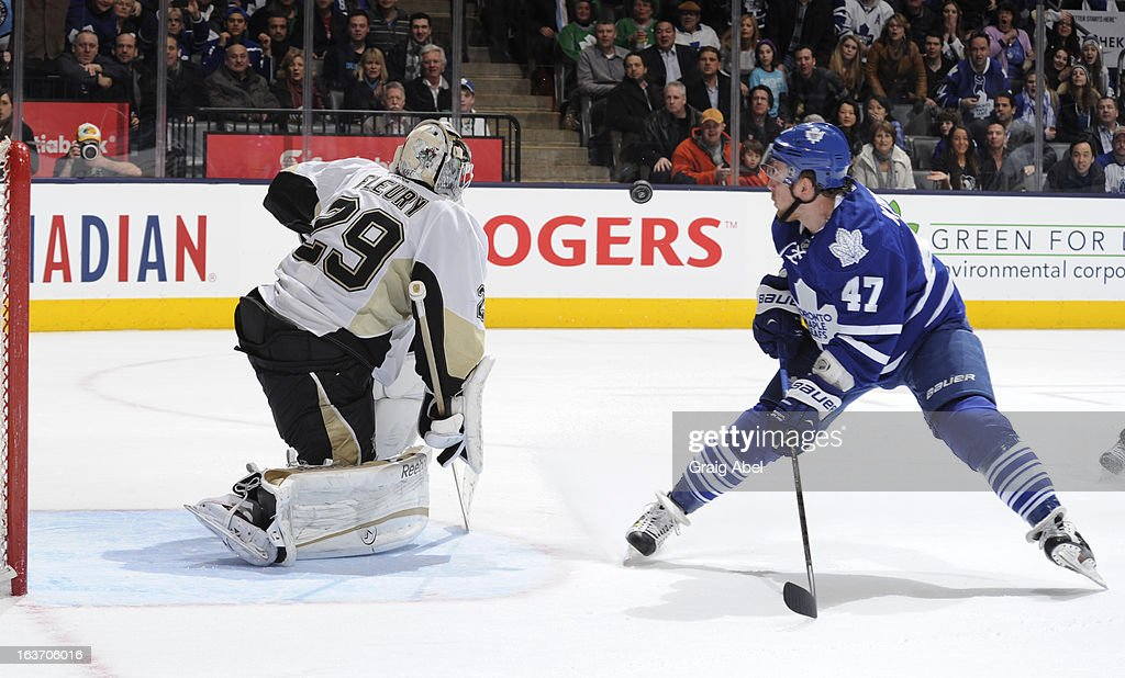 Leo Komarov #47 of the Toronto Maple Leafs has his shot stopped in close by <a gi-track='captionPersonalityLinkClicked' href=/galleries/search?phrase=Marc-Andre+Fleury&family=editorial&specificpeople=233779 ng-click='$event.stopPropagation()'>Marc-Andre Fleury</a> #29 of the Pittsburgh Penguins during NHL game action March 14, 2013 at the Air Canada Centre in Toronto, Ontario, Canada.