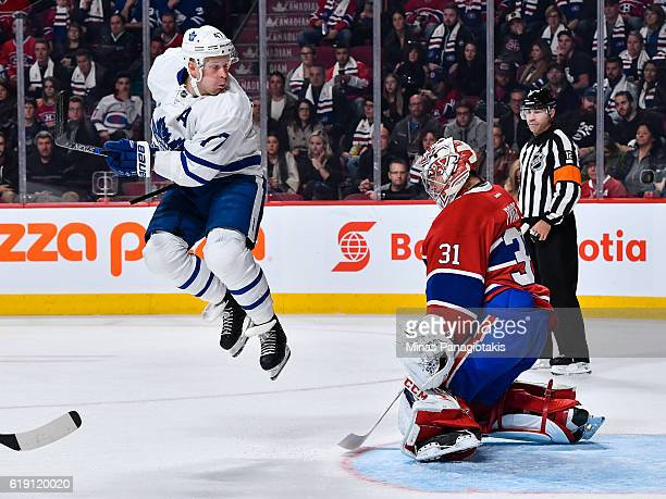 Leo Komarov of the Toronto Maple Leafs jumps in front of Carey Price of the Montreal Canadiens during the NHL game at the Bell Centre on October 29...