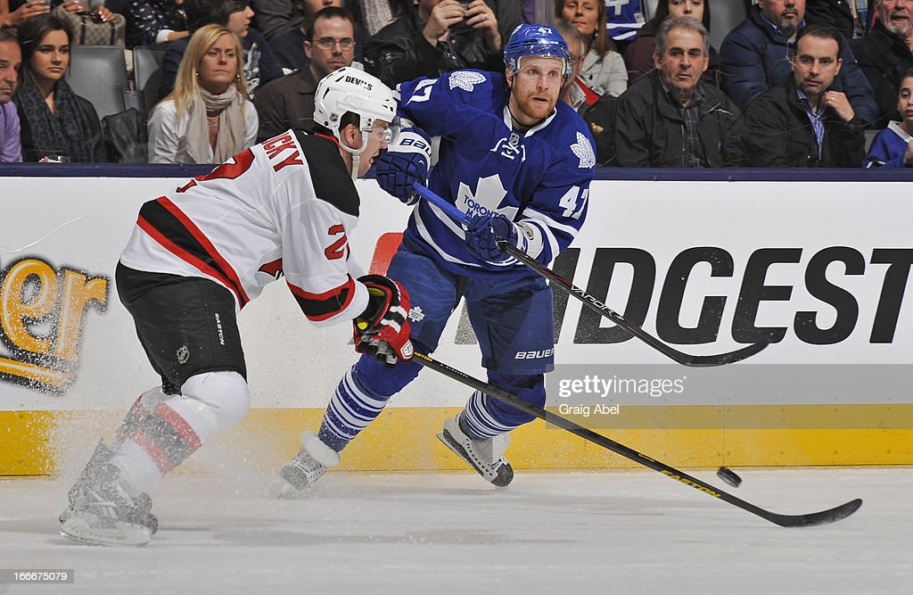 <a gi-track='captionPersonalityLinkClicked' href=/galleries/search?phrase=Leo+Komarov&family=editorial&specificpeople=883027 ng-click='$event.stopPropagation()'>Leo Komarov</a> #47 of the Toronto Maple Leafs passes the puck as <a gi-track='captionPersonalityLinkClicked' href=/galleries/search?phrase=Marek+Zidlicky&family=editorial&specificpeople=203291 ng-click='$event.stopPropagation()'>Marek Zidlicky</a> #2 of the New Jersey Devils defends during NHL game action April 15, 2013 at the Air Canada Centre in Toronto, Ontario, Canada.