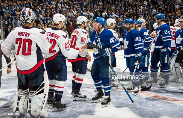 Leo Komarov of the Toronto Maple Leafs shakes hands with Kevin Shattenkirk of the Washington Capitals after the Capitals defeated the Leafs in...