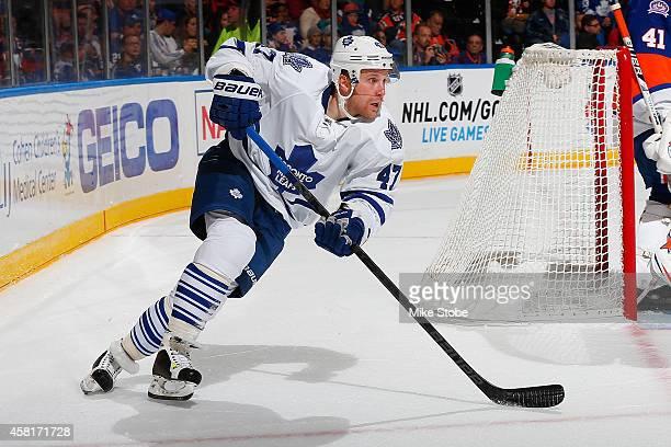 Leo Komarov of the Toronto Maple Leafs skates against the New York Islanders at Nassau Veterans Memorial Coliseum on October 21 2014 in Uniondale New...