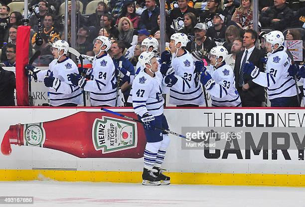 Leo Komarov of the Toronto Mapleleafs is congratulated by the bench after a goal against the Pittsburgh Penguins during the game at Consol Energy...