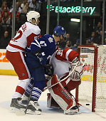 TORONTO ON NOVEMBER 22 Leo Komarov watches the puck slip past Jimmy Howard in first period action as the Toronto Maple Leafs play the Detroit Red...