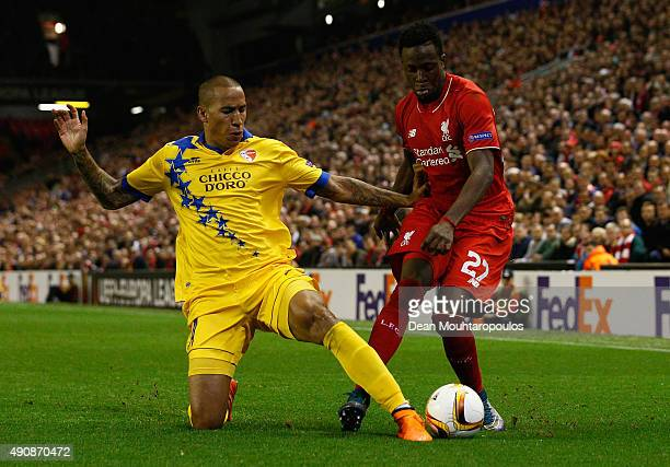 Leo Lacroix of FC Sion tackles Divock Origi of Liverpool during the UEFA Europa League group B match between Liverpool FC and FC Sion at Anfield on...