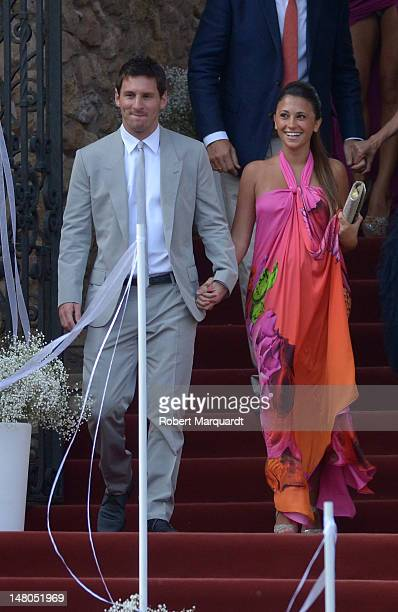 Leo Messi and Antonella Roccuzzo attend the wedding of Andres Iniesta and Ana Ortiz at the Castillo de Tamarit on July 8 2012 in Tarragona Spain