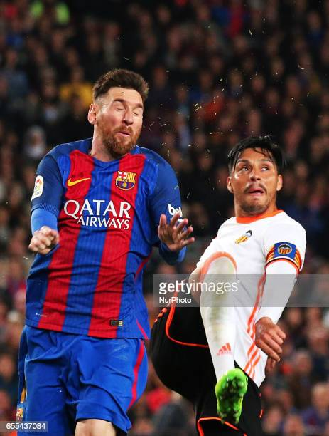 Leo Messi and Enzo Perez during La Liga match between FC Barcelona v Valencia CF in Barcelona on march 19 2017