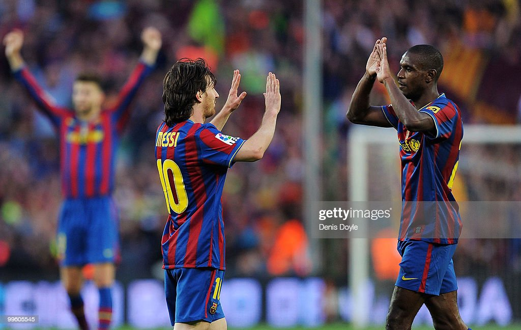 Leo Messi (L) and <a gi-track='captionPersonalityLinkClicked' href=/galleries/search?phrase=Eric+Abidal&family=editorial&specificpeople=469702 ng-click='$event.stopPropagation()'>Eric Abidal</a> celebrate after Barcelona beat Real Valladolid 4-0 to clinch La Liga title after their match at Camp Nou stadium on May 16, 2010 in Barcelona, Spain.