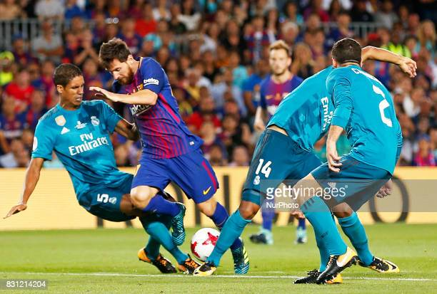 Leo Messi and Varane during the spanish Super Cup match between FC Barcelona v Real Madrid in Barcelona on August 13 2017