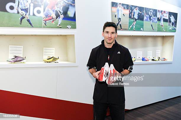 Leo Messi holds the adizero f50 Messi boots during his visit to the new adidas Messi Gallery on March 6 2013 in Barcelona Spain