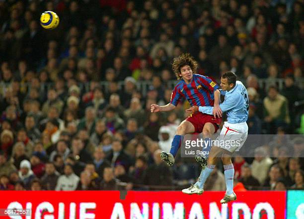 Leo Messi of Barcelona and Angel of Celta compete the ball in the air during La Liga match between FC Barcelona and Celta on December 20 2005 at the...