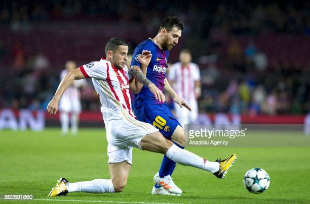 Leo Messi of Barcelona in action against Omar Elabdellaoui of Olympiacos during the UEFA Champions League Group D soccer match between Barcelona and...