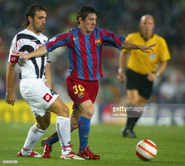 Leo Messi of FC Barcelona and Valerio Bertotto in action during the UEFA Champions League Group A match between FC Barcelona and Udinese played at...