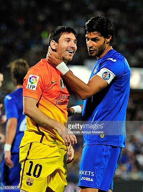 Leo Messi of FC Barcelona jokes with Miguel Torres of Getafe CF during the La Liga match between Getafe CF and FC Barcelona at Coliseum Alfonso Perez...