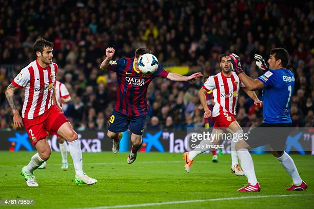 Leo Messi of FC Barcelona tries to score between Marco Torsiglieri and Esteban Suarez of UD Almeria during the La Liga match between FC Barcelona and...