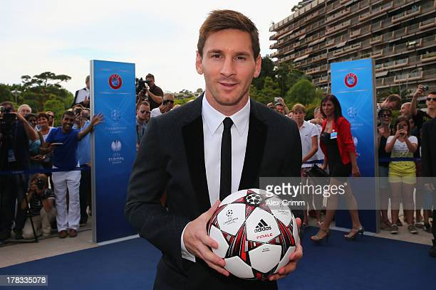 Leo Messi poses outside the Grimaldi Forum with the adidas official match ball 'Finale 13' prior to the Champions League Draw on August 29 2013 in...