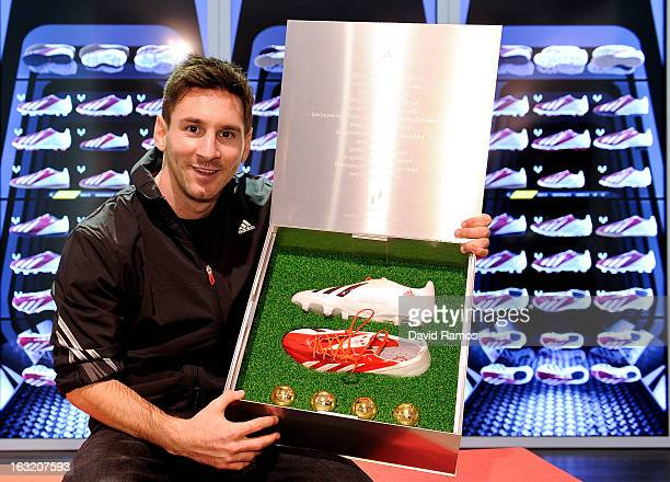 Leo Messi receives his adizero f50 Messi boots presented during his visit to the new adidas Messi Gallery on March 6 2013 in Barcelona Spain
