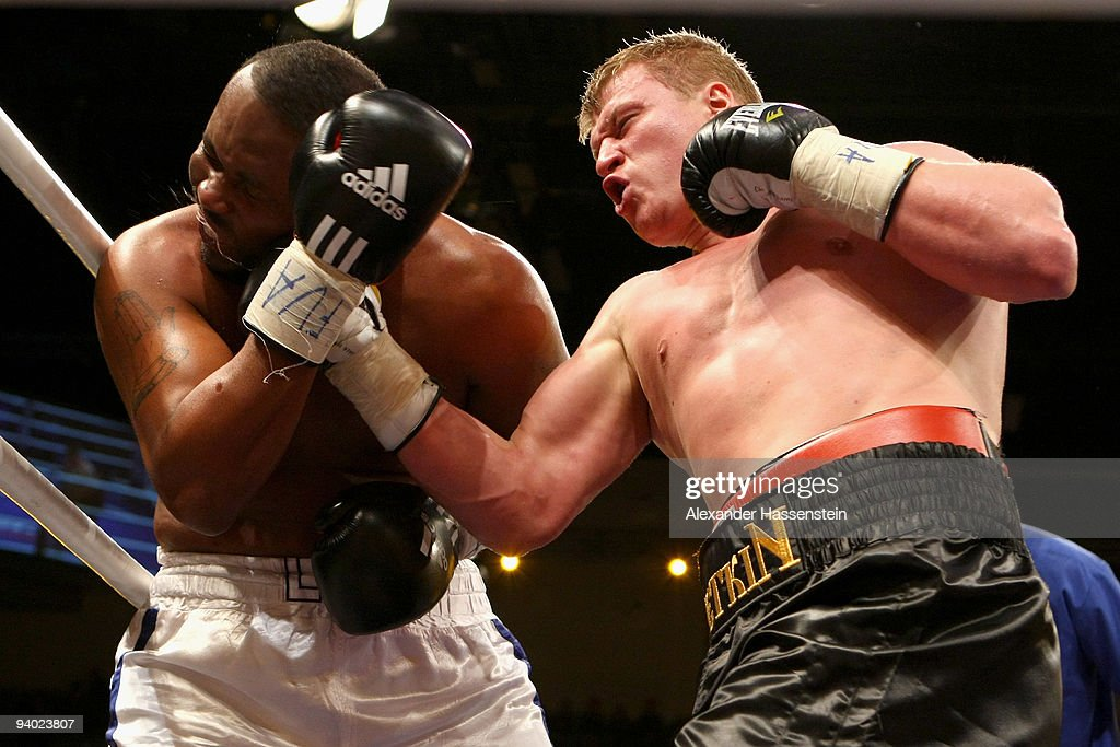 Leo Nolan (L) of the US and <a gi-track='captionPersonalityLinkClicked' href=/galleries/search?phrase=Alexander+Povetkin&family=editorial&specificpeople=2351769 ng-click='$event.stopPropagation()'>Alexander Povetkin</a> of Russia exchange punches during their Heavyweight fight at the Arena Ludwigsburg on December 5, 2009 in Ludwigsburg, Germany.