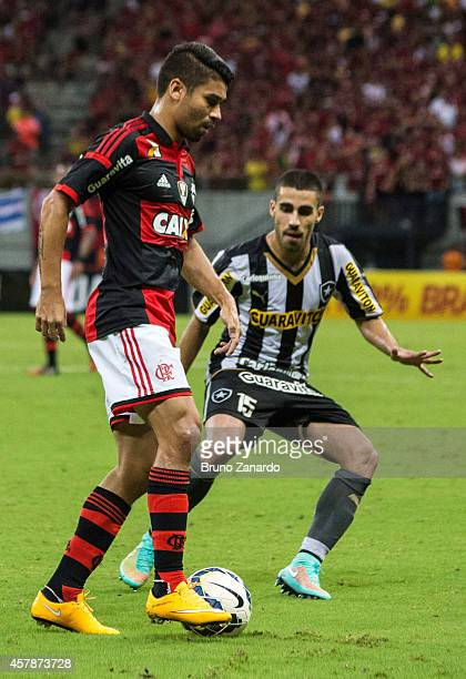 Leo of Flamengo competes for the ball with Gabriel of Botafogo during the Brasileirao Series A 2014 match between Flamengo and Botafogo at Arena da...