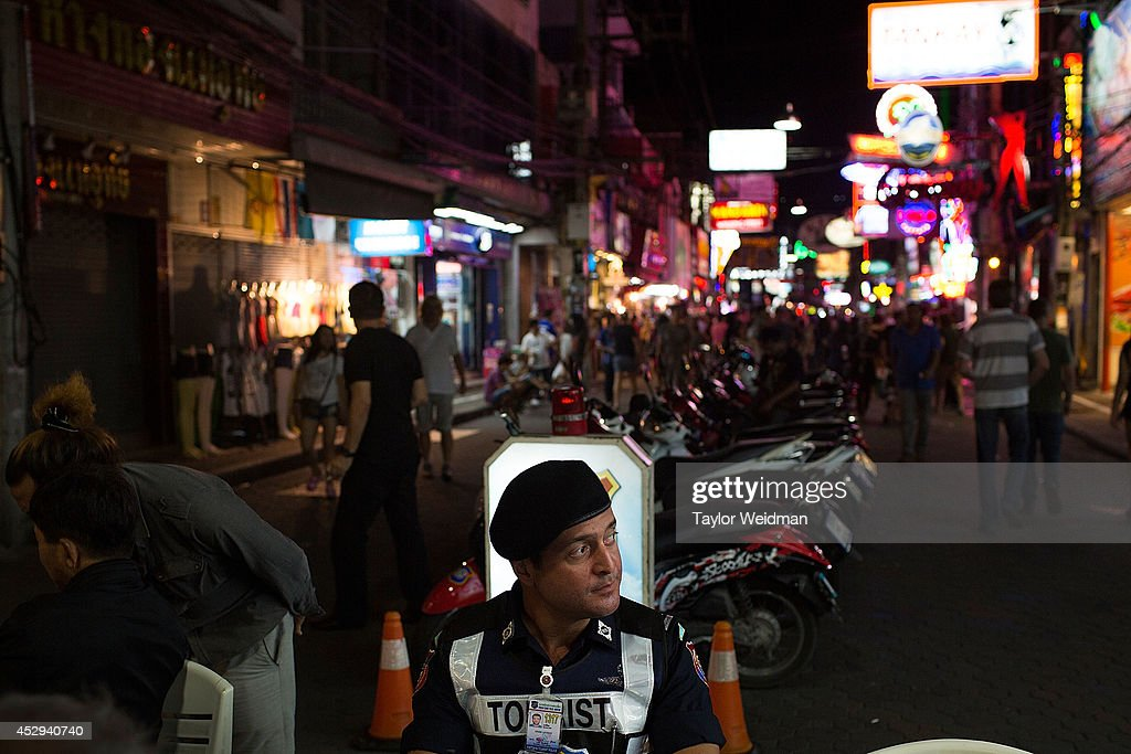 Leo Oner, a member of FTPA, sits at the mobile headquarters of the Tourist Police on Pattaya's Walking Street on July 31, 2014 in Pattaya, Thailand. Since 2002, members of the Foreign Tourist Police Assistants (FTPA) of Pattaya have been assisting local police on Walking Street, Pattaya's main nightlife area. Members of the FTPA carry handcuffs, batons, and pepper spray, and are charged primarily with assisting foreign visitors and the Thai police, as well as breaking up fights and catching thieves.