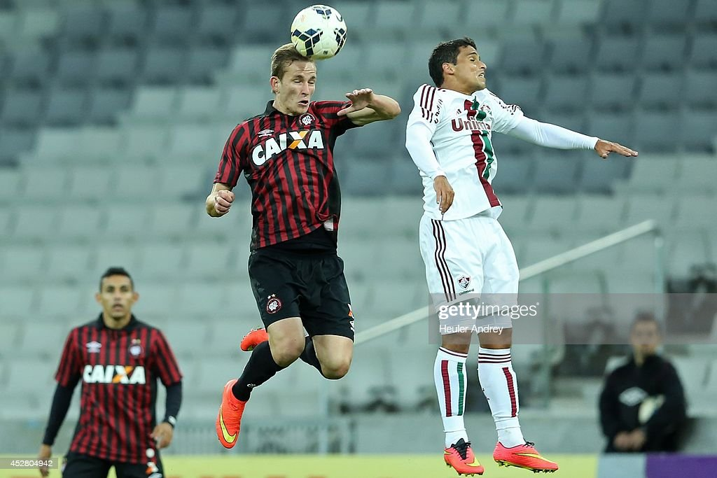 Leo Pereira of Atletico-PR competes for the ball with Jean of Fluminense during the match between Atletico-PR and Fluminense for the Brazilian Series A 2014 at Arena da Baixada on July 27, 2014 in Curitiba, Brazil.