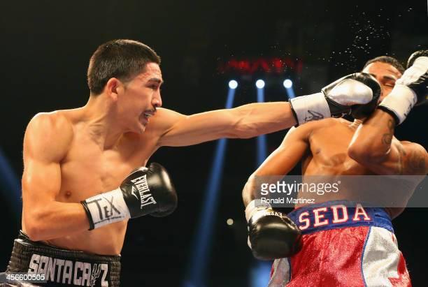 Leo Santa Cruz and Cesar Seda during their WBC Super Bantamweight title bout at Alamodome on December 14 2013 in San Antonio Texas