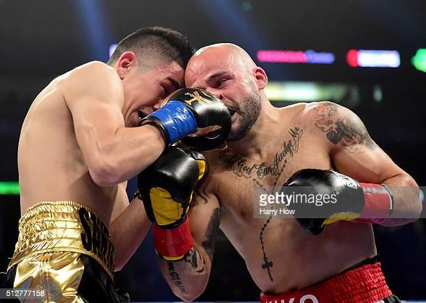 Leo Santa Cruz and Kiko Martinez bump heads as Santa Cruz retains the WBA Featherweight Super title with a fifth round TKO at Honda Center on...