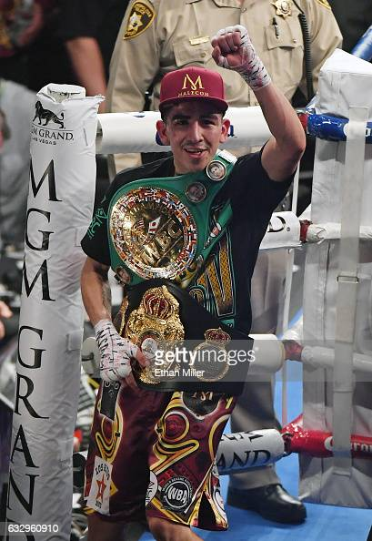 Leo Santa Cruz celebrates as he leaves the ring after defeating Carl Frampton by majority decision to win their WBA featherweight title fight at MGM...