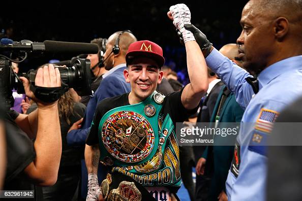 Leo Santa Cruz celebrates his majority decision win over Carl Frampton after their WBA featherweight title fight at MGM Grand Garden Arena on January...