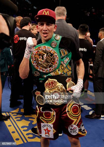 Leo Santa Cruz celebrates his majority decision win over Carl Frampton after their WBA featherweight title fight at the MGM Grand Arena in Las Vegas...