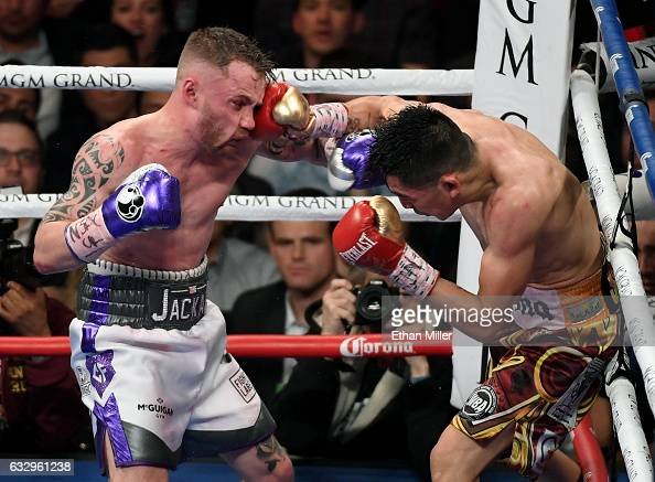 Leo Santa Cruz hits Carl Frampton with a right in the 10th round of their WBA featherweight title fight at MGM Grand Garden Arena on January 28 2017...