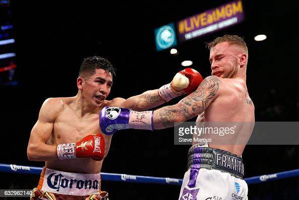 Leo Santa Cruz lands a punch on Carl Frampton during their WBA featherweight title fight at MGM Grand Garden Arena on January 28 2017 in Las Vegas...