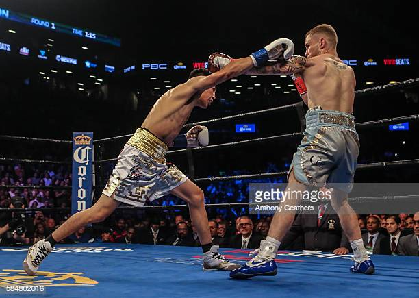 Leo Santa Cruz of Mexico fights Carl Frampton of Northern Ireland during their 12 round WBA Super featherweight championship bout at Barclays Center...