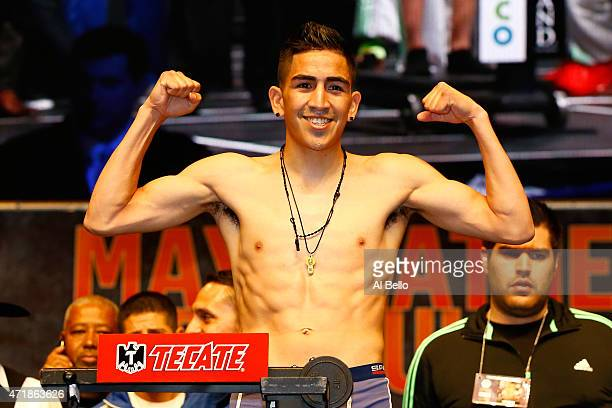 Leo Santa Cruz poses as he steps on the scale during his official weighin for his bout against Jose Cayetano on May 1 2015 at MGM Grand Garden Arena...