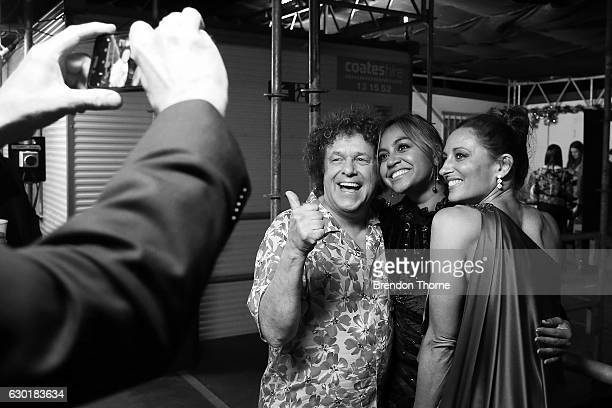 Leo Sayer Jessica Mauboy and Georgie Parker pose for a 'selfie' backstage during Woolworths Carols in the Domain at The Domain on December 18 2016 in...