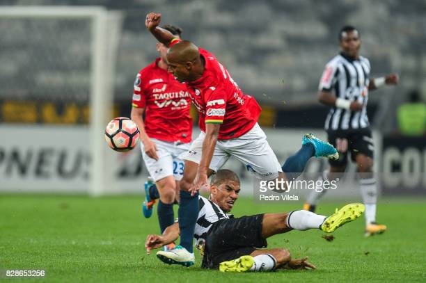 Leo Silva of Atletico MG and Serginho of Jorge Wilstermann battle for the ball during a match between Atletico MG and Jorge Wilstermann as part of...