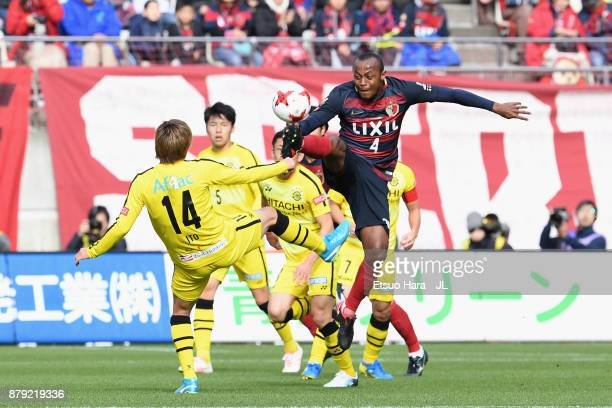 Leo Silva of Kashima Antlers and Junya Ito of Kashiwa Reysol compete for the ball during the JLeague J1 match between Kashima Antlers and Kashiwa...