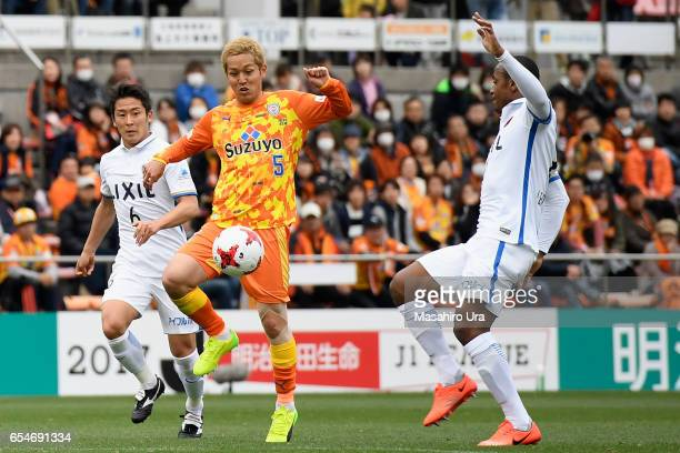 Leo Silva of Kashima Antlers and Shoma Kamata of Shimizu SPulse compete for the ball during the JLeague J1 match between Shimizu SPulse and Kashima...