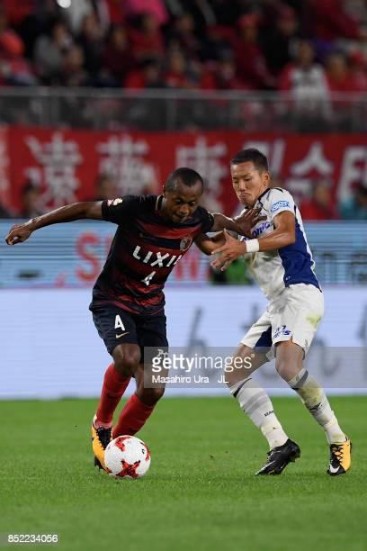 Leo Silva of Kashima Antlers and Yosuke Ideguchi of Gamba Osaka compete for the ball during the JLeague J1 match between Kashima Antlers and Gamba...