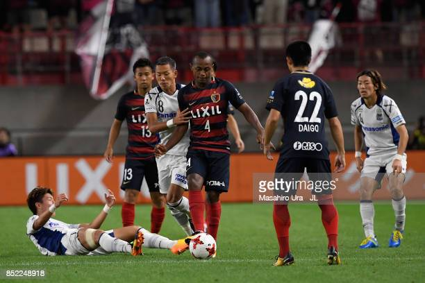 Leo Silva of Kashima Antlers and Yosuke Ideguchi of Gamba Osaka reacts during the JLeague J1 match between Kashima Antlers and Gamba Osaka at Kashima...