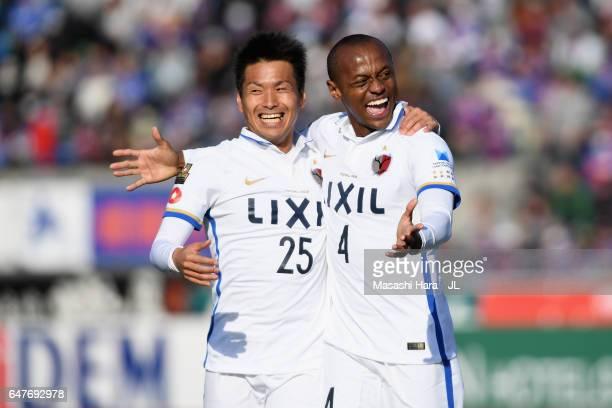 Leo Silva of Kashima Antlers celebrates scoring the opening goal with his team mate Yasushi Endo during the JLeague J1 match between Ventforet Kofu...