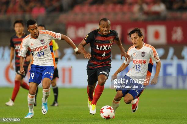Leo Silva of Kashima Antlers competes for the ball against Musashi Suzuki and Masaru Kato of Albirex Niigata during the JLeague J1 match between...