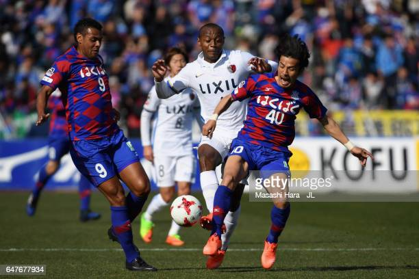 Leo Silva of Kashima Antlers competes for the ball against Wilson and Shohei Ogura of Ventforet Kofu during the JLeague J1 match between Ventforet...