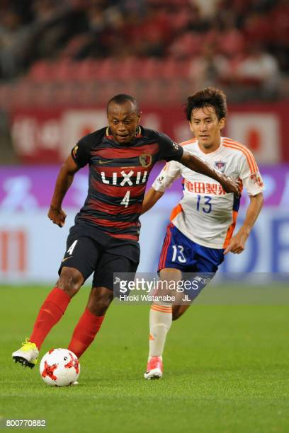 Leo Silva of Kashima Antlers controls the ball under pressure of Masaru Kato of Albirex Niigata during the JLeague J1 match between Kashima Antlers...