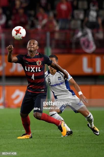 Leo Silva of Kashima Antlers controls the ball under pressure of Yosuke Ideguchi of Gamba Osaka during the JLeague J1 match between Kashima Antlers...