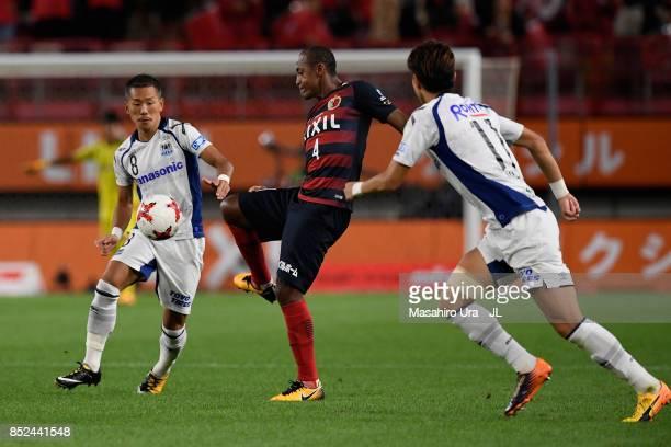 Leo Silva of Kashima Antlers controls the ball under pressure of Yosuke Ideguchi and Hwang Ui Jo of Gamba Osaka during the JLeague J1 match between...