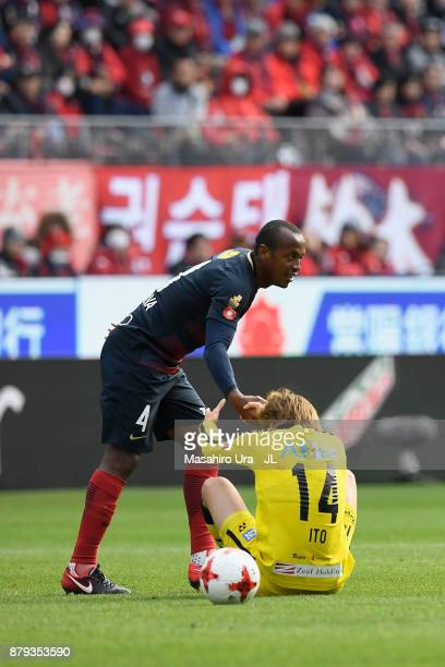 Leo Silva of Kashima Antlers helps Junya Ito of Kashiwa Reysol during the JLeague J1 match between Kashima Antlers and Kashiwa Reysol at Kashima...