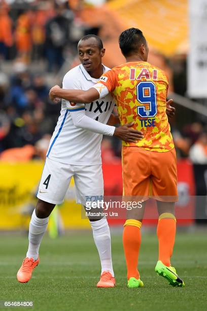 Leo Silva of Kashima Antlers is embraced by Chong Tese of Shimizu SPulse after the JLeague J1 match between Shimizu SPulse and Kashima Antlers at IAI...